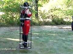 spandex bondage doll jewell caged and stored in silo