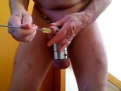 self torture with bottlebrush in peehole