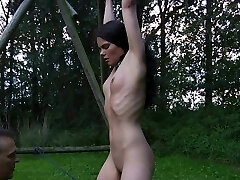 Hardcore slave tied and tortured outside