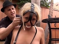 Strapped up blonde in restrain bondage
