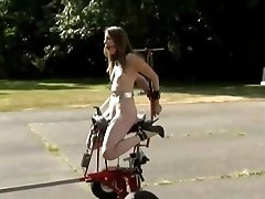 Abased whore machine fucking in public
