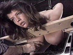 Isabelle gets her immense tits tortured