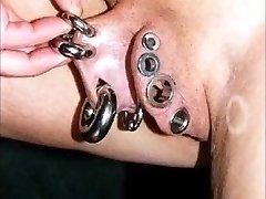 Slideshow extreme piercing pussy