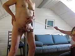 Cane on prick and ball sack in humbler