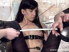 Feet tortures of slave Elise Graves in dungeon bondage