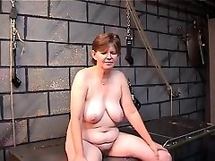 Old hoe's filthy ass goes red from spiked mitten spanking in dungeon