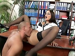 Smoking molten brunette with glasses rides her boss in his office