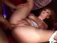 A Redhead Gets Herself Double Penetrated