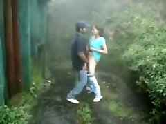 Brit Indian couple poke in rain storm at hill station