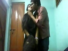 School students lovers at home