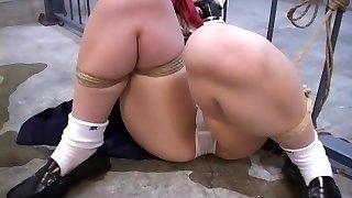 She is bound up to the prison cell and toy fucked