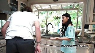 Petite Asian sans panties boning in kitchen