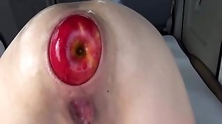 Giant anal apple insertions and fisting