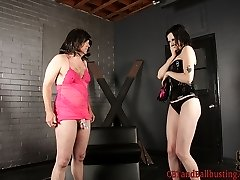 Femdom Annika humiliates her slave by forcing him to dress up in bad drag, complete with a wig....
