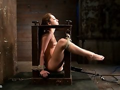 pRemy is bound in a wooden open framed box with her knees up, exposing her vulnerable pussy. A...