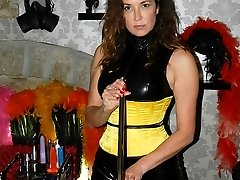 Strapon Jane rounds up her slaves in the dungeon for some deep throat action on her big strapon...