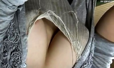 Busty Japanese uses her orbs
