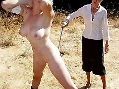 Shameful naked outdoor spanking for two hot filthy bitches