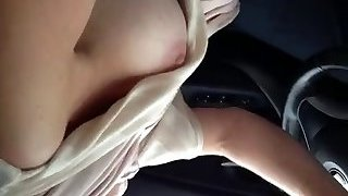My slutty busty wifey loves to drive a car flashing her milk cans