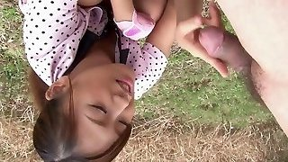 Japanese teen is on her knees deepthroating cock outdoors