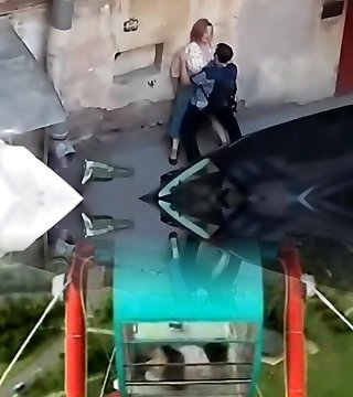 Snooping a giant girl get fucked from balcony