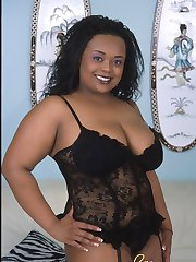 Chubby boobed ebony bbw in stockings showing her fat booty