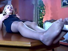 Strapon-armed chick licks sweet nyloned feet before freaky lesbian foot sex
