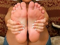 Grubby blonde cutie has her sexy crimson painted toes licked and sucked
