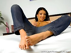 Foot freak massages this stud with her beautiful feet