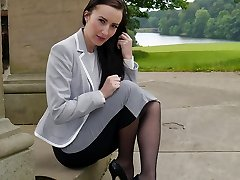 Uber-sexy brown-haired Sophia gets out the office to walk and tease outdoors in nylon stockings and high stiletto high-heeled shoes