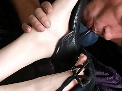 Sara Liz calls for her footslave to come and clean her dirty shoes. He says they taste like dog shit, but resumes to lick the soles of her shoes clean. The sole slave kisses the bottoms of Sara Liz's feet, and rubs them softly. Sara Liz gets her foot slave beneath her so she can slap his face with the feet of her feet.