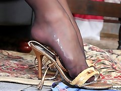 Mischievous babe squeezing stiff pole with her sexy feet in black pantyhose