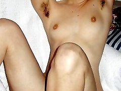 Slim Elena flaunts her hairy pussy and armpits