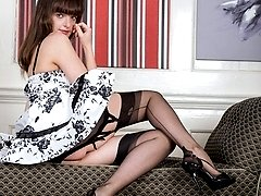 Kate Anne is thrilled to be in a nice full skirted frock, and heels with a VERY raunchy girdle...