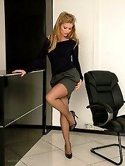 Leggy Kathryn shows her gorgeous black nylon legs and tall shiny stilettos, as she struts around...