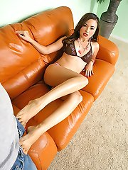 Asian hottie gives one mean foot job to a well hung stud