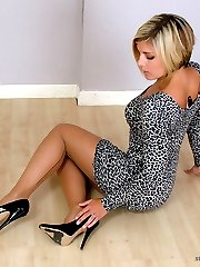 Stunning babe Naomi is dressed up in a very short dress flashing her sexy legs and shiny black...