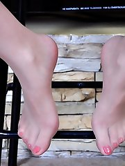 Pervy chick licks her high heels and shows off red painted nylon clad toes