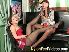 Lesbian gals in smooth pantyhose playing foot games and using beloved dildo