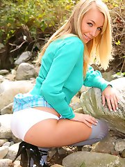Beauty college girl removes her uniform and stays in nothing but panties and over the knee socks.