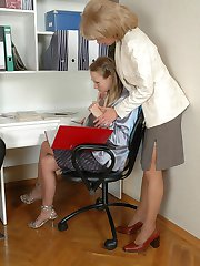 Older lady-boss seducing her younger secretary into freaky pantyhose sex
