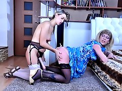 Blonde crossdresser in a girlie blue dress lured into a steamy strapon fuck