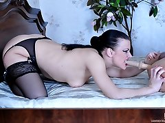 Nasty raven-head pulls a dildo out of her stocking to fuck her eager lover
