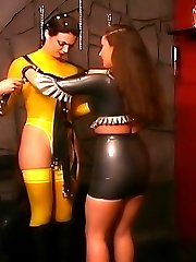 Dominant lady dresses a submissive girl and takes her to outdoor training