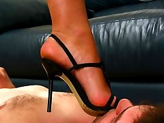Incomparable blonde mistress with amazing feet lets the slave to suck her toes