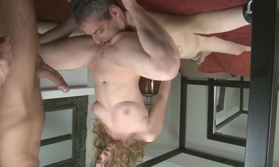 Horny MILF fucking her cunt with two giant cucumbers