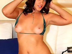 Sweet young thing stretches her ass with huge toys
