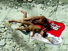 Young nude beach couple in a selfless sex act