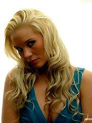 Leggy blonde Zara shows off her gorgeous stockinged legs and shiny high stilettos