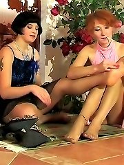 Steamy lesbian babes in silky tights tongue-polishing nylon feet on floor